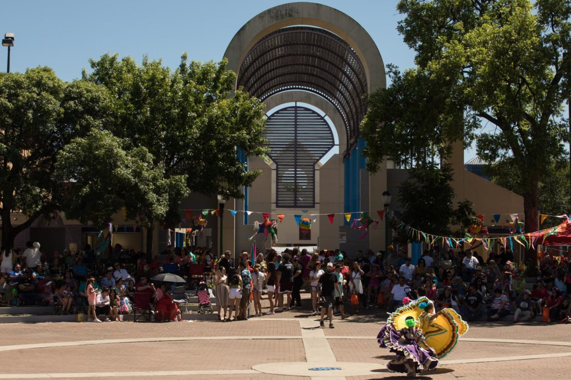The Danzavida dance troupe performs a number in a crowded Guadalupe Plaza.