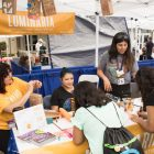 Volunteers with Luminaria spread the word about the event.