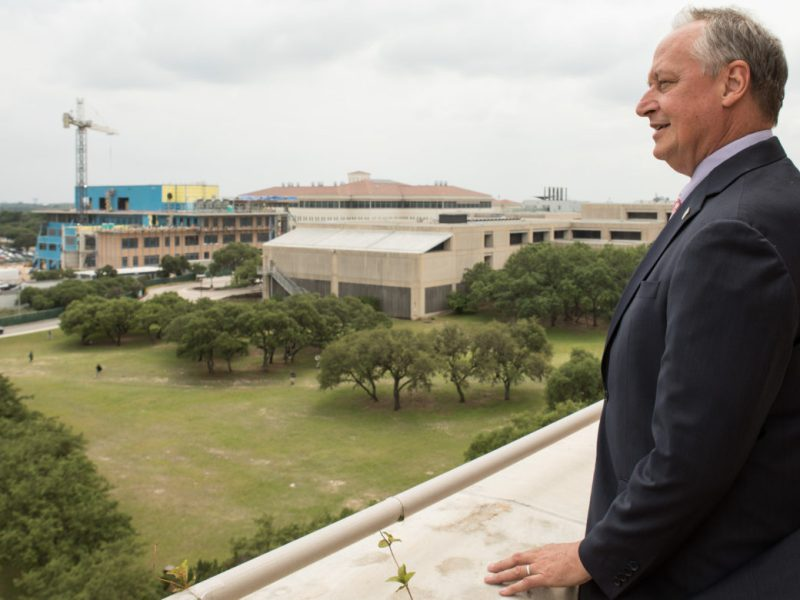 UTSA President Taylor Eighmy looks out at the new construction on the main campus.