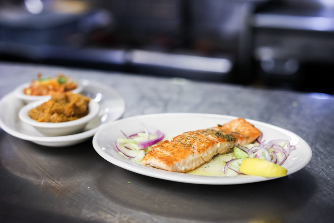 The 8 ounce salmon with two vegetables and cucumber sauce.