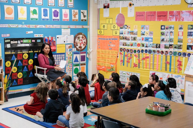 Dual language teacher Miriam Hernandez reads to her students in Spanish.