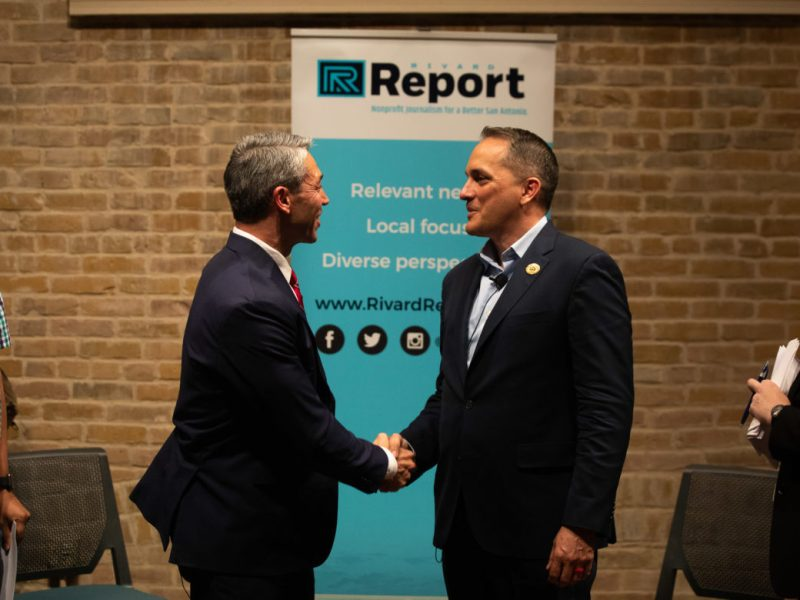 Mayor Ron Nirenberg (left) and Councilman Greg Brockhouse shake hands during the debate hosted by the Rivard Report at The Spire at Saint Paul's Square.