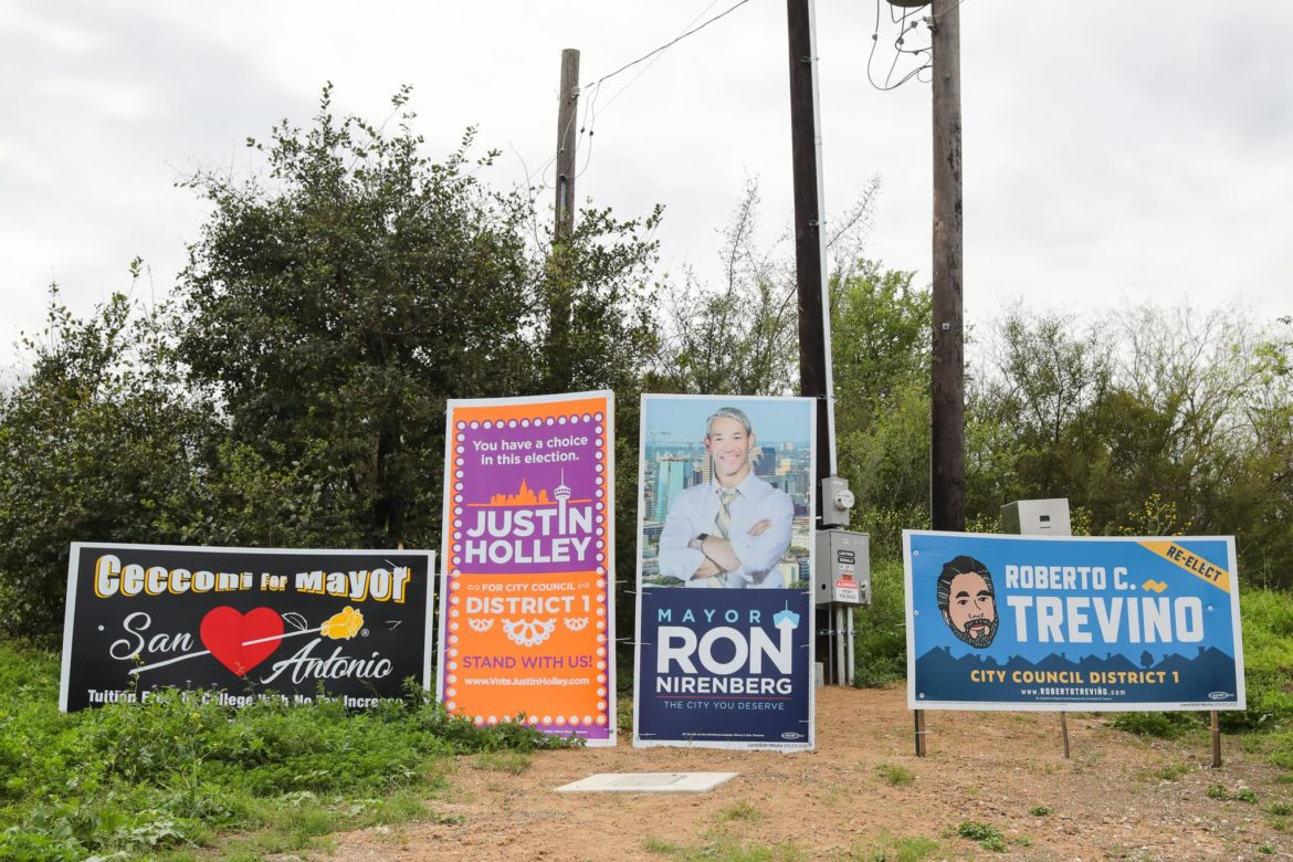 Campaign signage at the corner of Hildebrand and US 281 Southbound towards downtown San Antonio features mayoral and District 1 races.