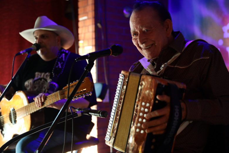 Flaco Jimenez plays on his accordion during his 80th birthday.