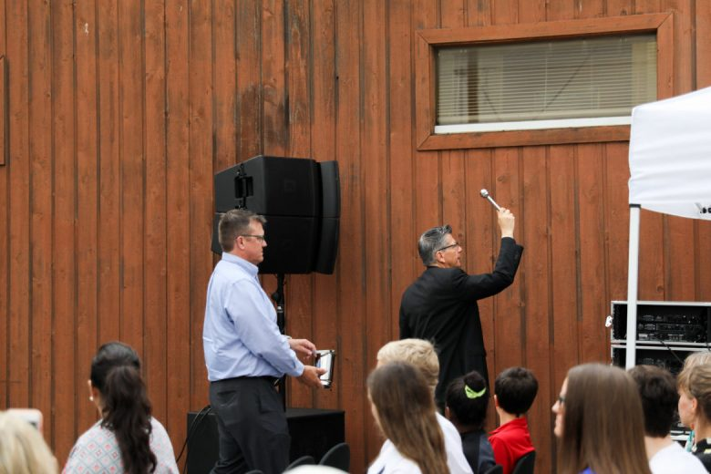 Archbishop Gustavo García-Siller blesses the new building with holy water.