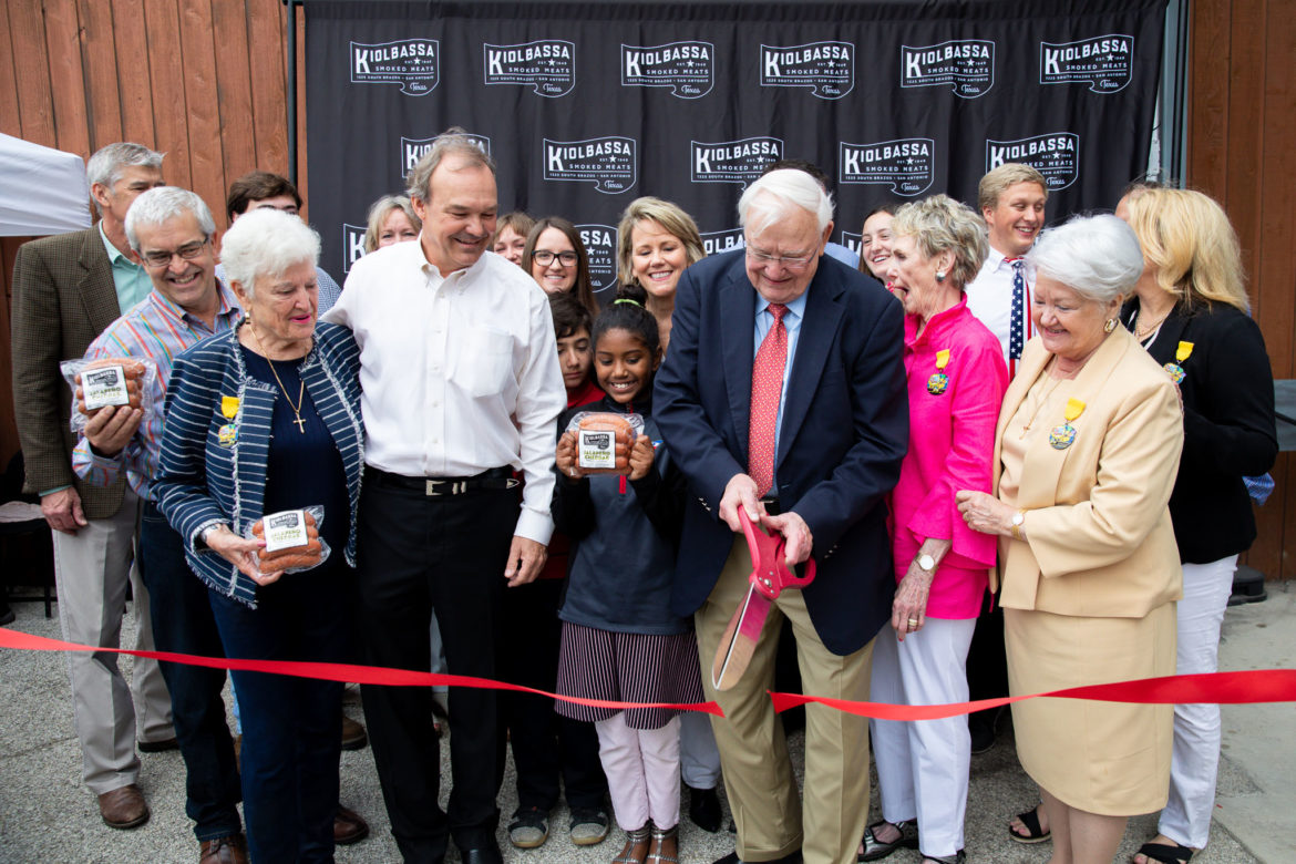 The Kiolbassa family led by Robert Kiolbassa as they cut the ribbon on the expanded sausage factory building.