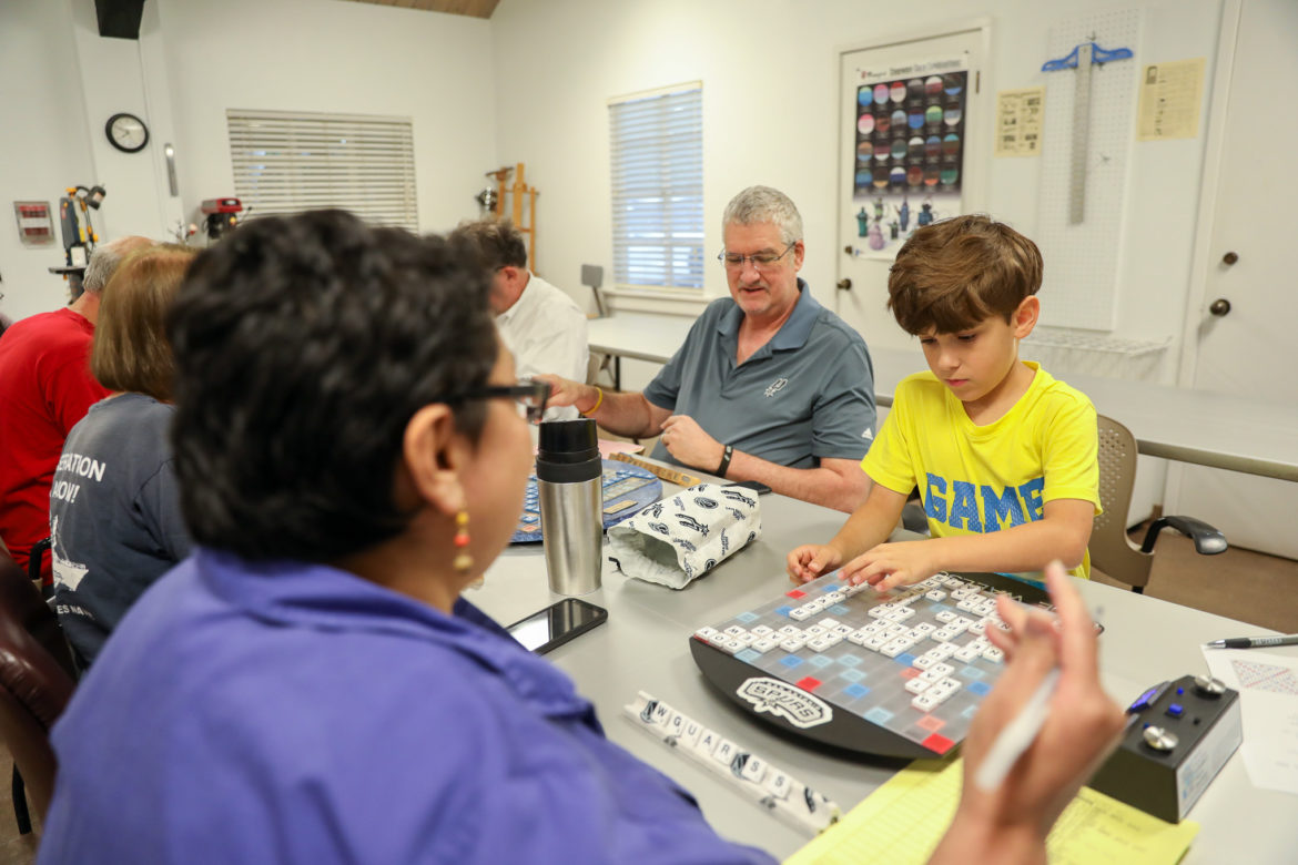 Ricky Rodriguez plays a bingo against opponent Norma DeJesus during a match at the Lion's Field Senior Center Scrabble Club.