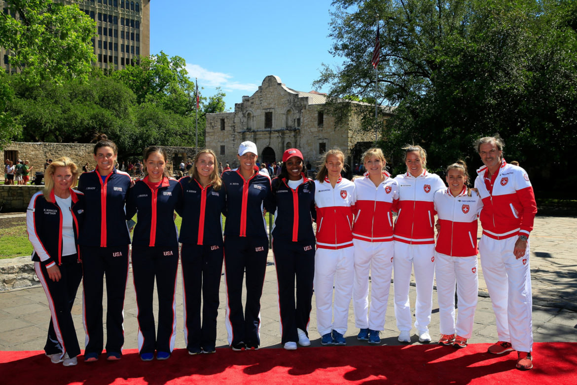 Team USA, including Kathy Rinaldi, Jennifer Brady, Jessica Pegula, Sofia Kenin, Madison Keys, Sloane Stephens and Team Switzerland including Ylena In-Albon, Conny Perri, Timea Bacsinszky, Viktorija Golubic and Heinz Guenthardt pose during the 2019 Fed Cup Draw Ceremony at The Alamo in San Antonio, Texas.