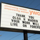 The YWCA Olga Madrid Center pays tribute to Olga Madrid on the marquee.