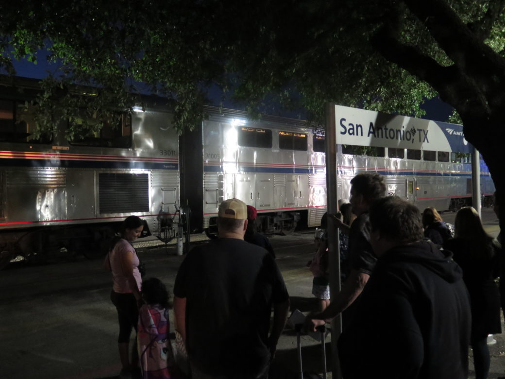 People gather at the San Antonio Amtrak station to board their train.