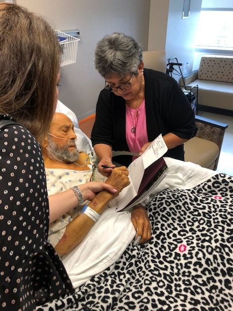 Andy Sarabia votes while in hospice with the help of his wife, Linda Ledesma.