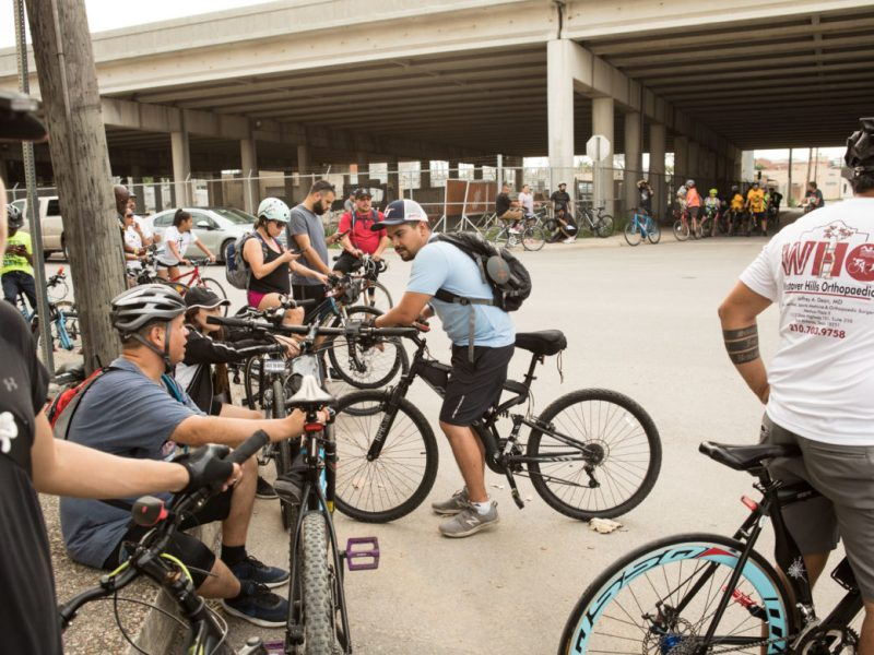 Cyclists prepare to ride their bikes from Burleson Yard Beer Garden.