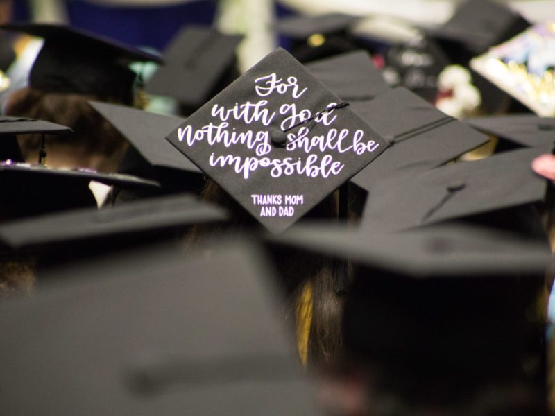 Graduation candidates' decorated mortar boards display a mélange of color and messaging.