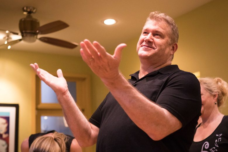 """Lee Cusenbury gestures as he gives a speech during rehearsal for """"An Adventurer's Journey."""""""