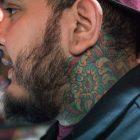Raul Ortiz's neck tattoo depicts a Chrysanthemum.