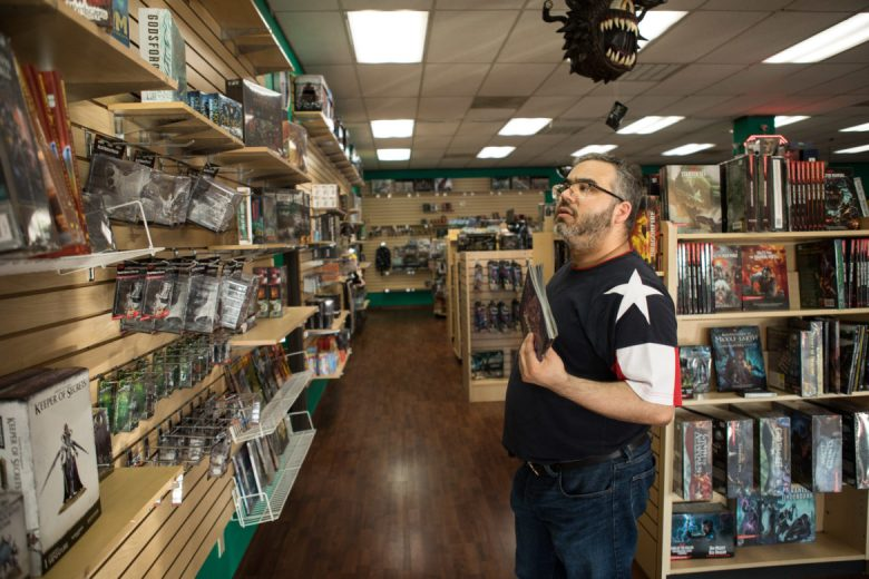 James Benavides searches through comics he doesn't have in Dragon's Lair.