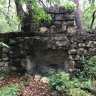 The ruins of an old chimney and walls left over from a former Girl Scout camp at what is now Olmos Basin Park.