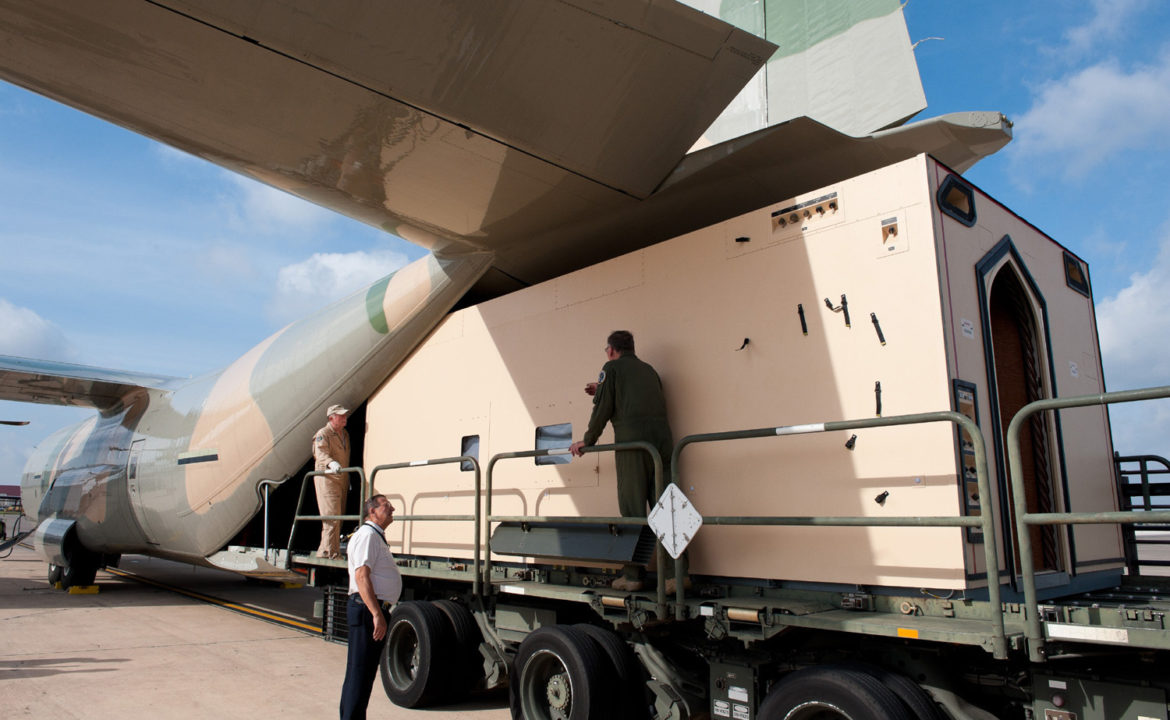 A Knight Aerospace cabin is loaded into a C-130J aircraft at Kelly Field.