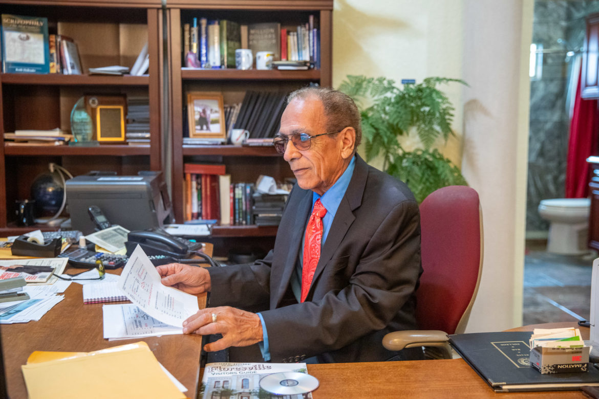 Roy Idrach spends a good portion of his day trading stock at his home office.