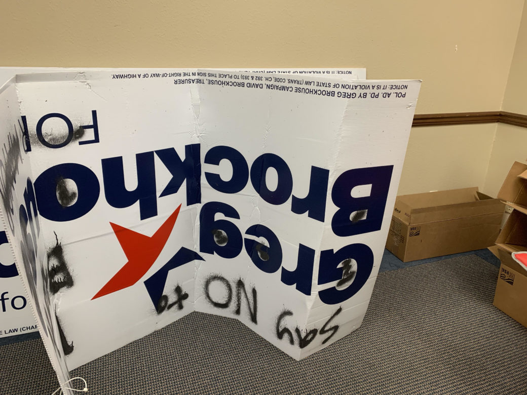 Defaced signs were taken down and placed in Greg Brockhouse's campaign office.