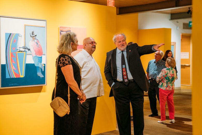 (right) Michael Duchemin, president and CEO of the Briscoe Western Art Museum speaks to attendees during the opening of <I>Into a New West</I>.