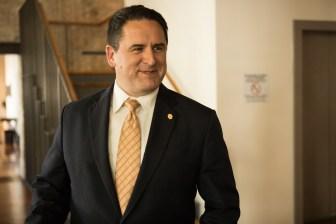 City Manager Erik Walsh exits Plaza de Armas to attend a city council meeting.