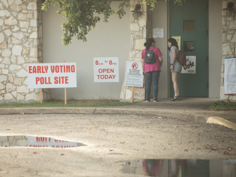 Two young woman enter the Lion's Field poll site.