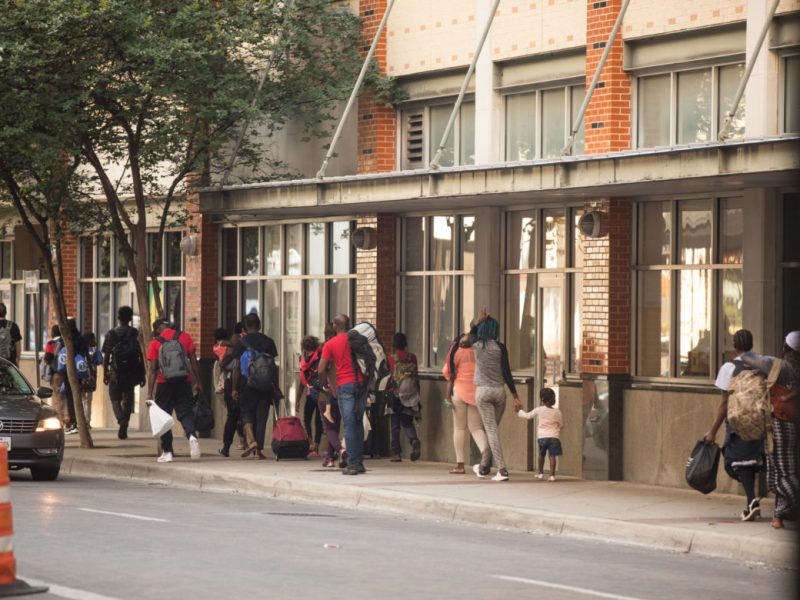 Congolese migrants walk from Travis Park Church to the Resource Center.