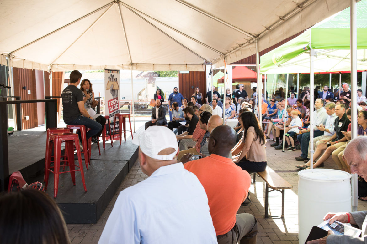 (From left) Tech Bloc CEO David Heard and Councilwoman Shirley Gonzales (D5) speak in front of a large crowd at Alamo Beer.