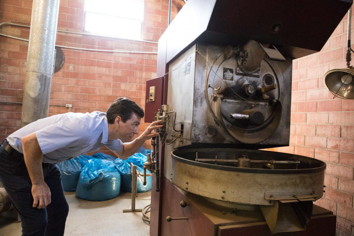 What's Brewing Coffee Roasters co-owner Tony Chbeir looks at the original machine the company used.