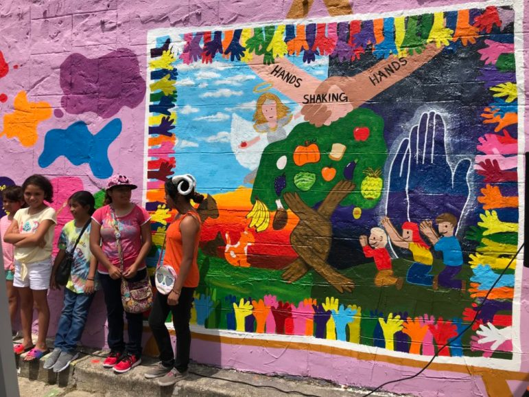 """Kids in the San Anto Cultural Arts after-school program worked together to create the """"Hands Shaking Hands"""" mural."""