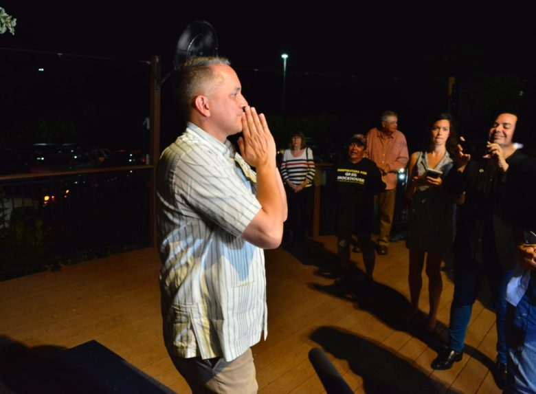 Greg Brockhouse gestures to supporters after conceding defeat to incumbent Mayor Ron Nirenberg.