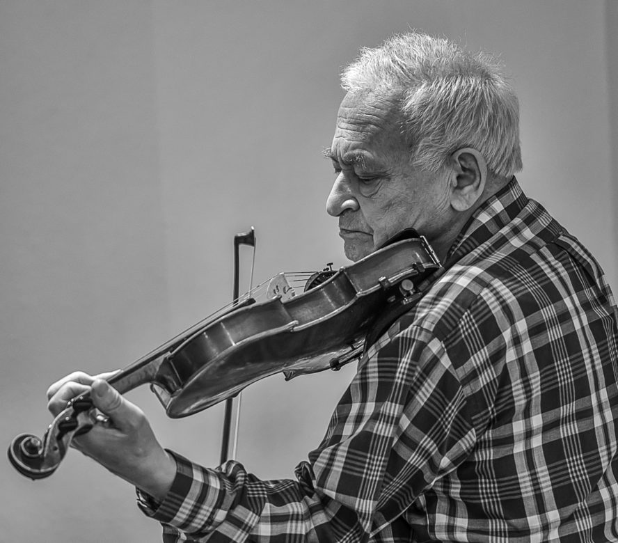 The late Yuri Sheyket practices his violin.