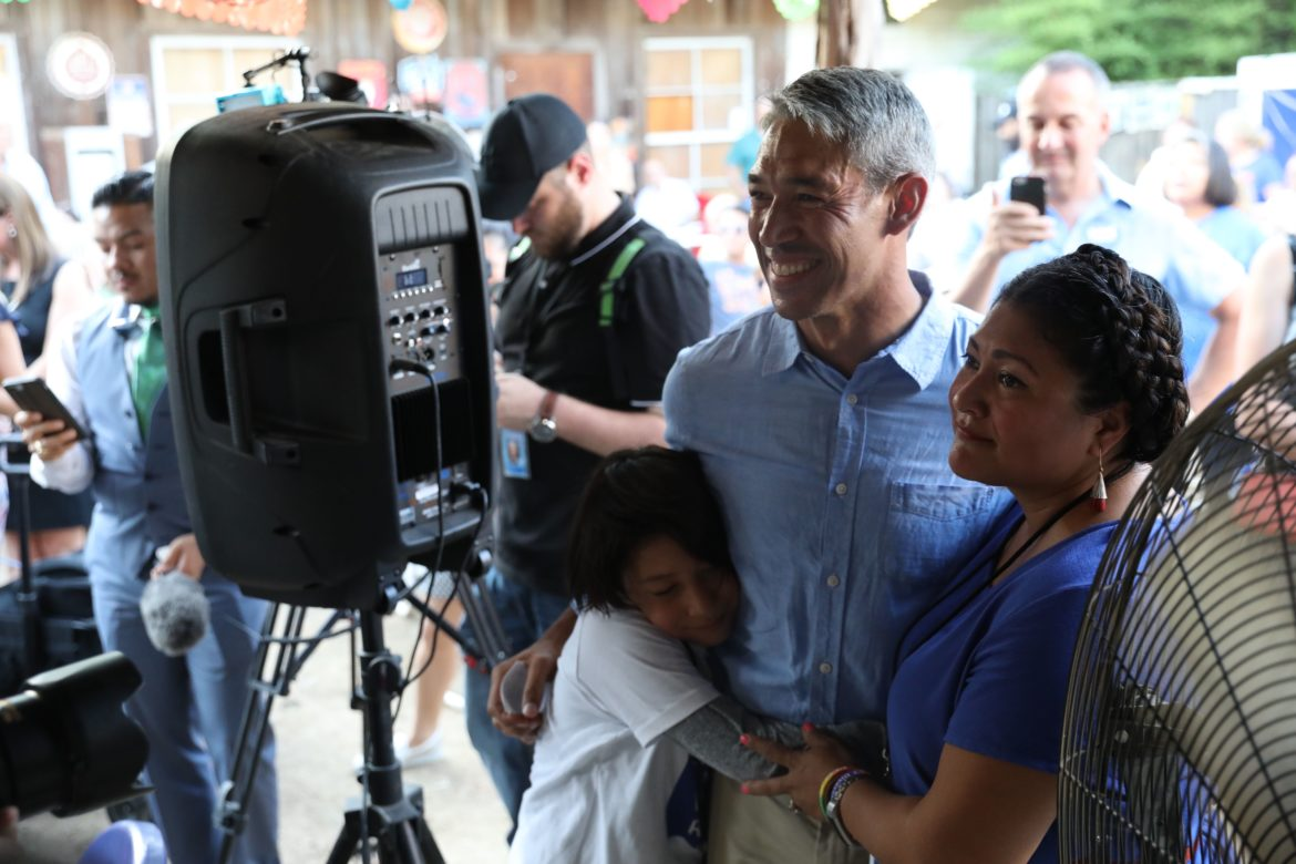 Mayor Ron Nirenberg embraces his family before he addresses supporters at Friendly Spot.