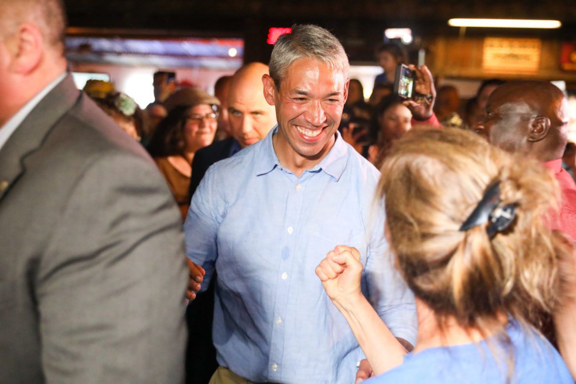 Mayor Ron Nirenberg celebrates after learning he has pulled off a victory over challenger Greg Brockhouse in a tight race.