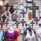 Decorative crosses and traditional dresses line the walls of La Boutique International at Market Square.