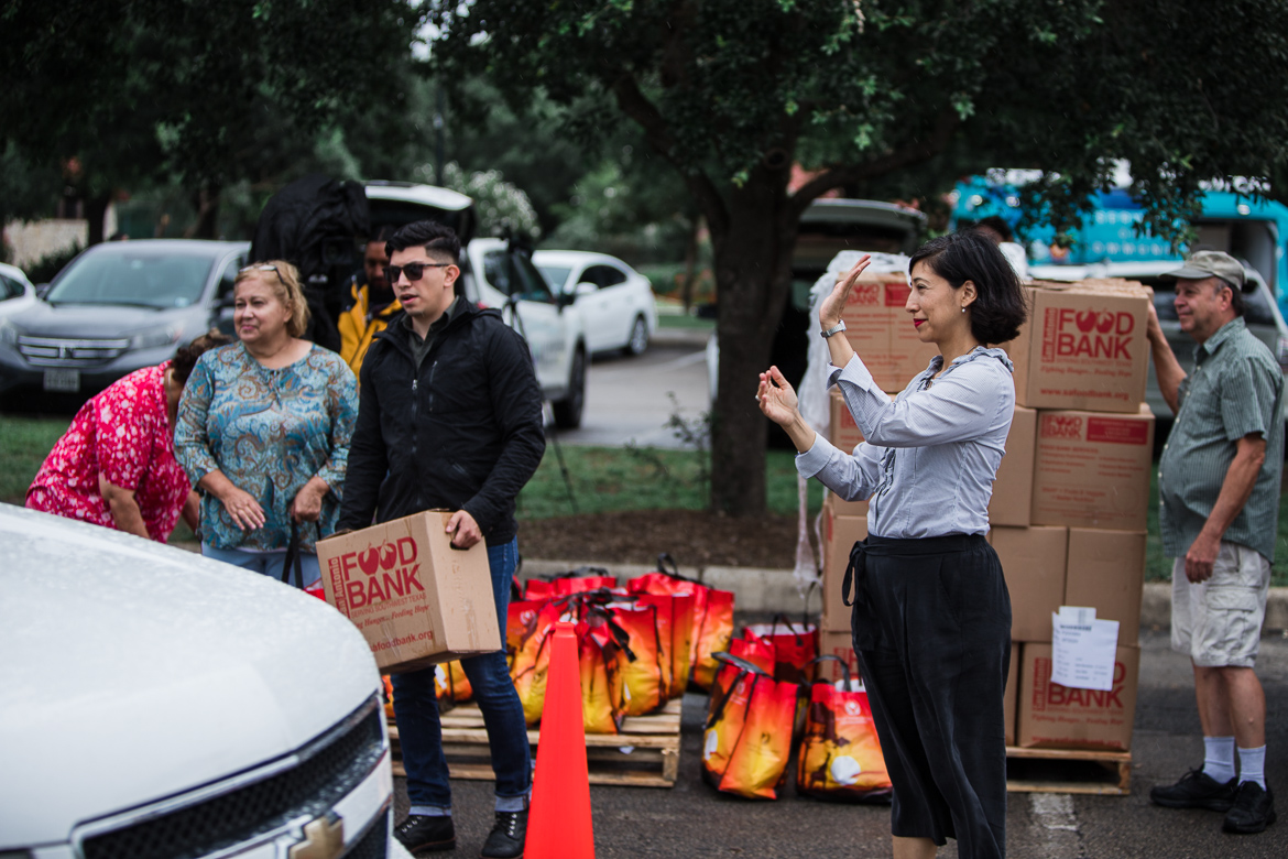 Councilwoman Ana E. Sandoval, District 7 directs vehicles of victims effected by last week's storm and receives a box of food from the San Antonio Food Bank at Woodlawn Lake Park on June 11, 2019.