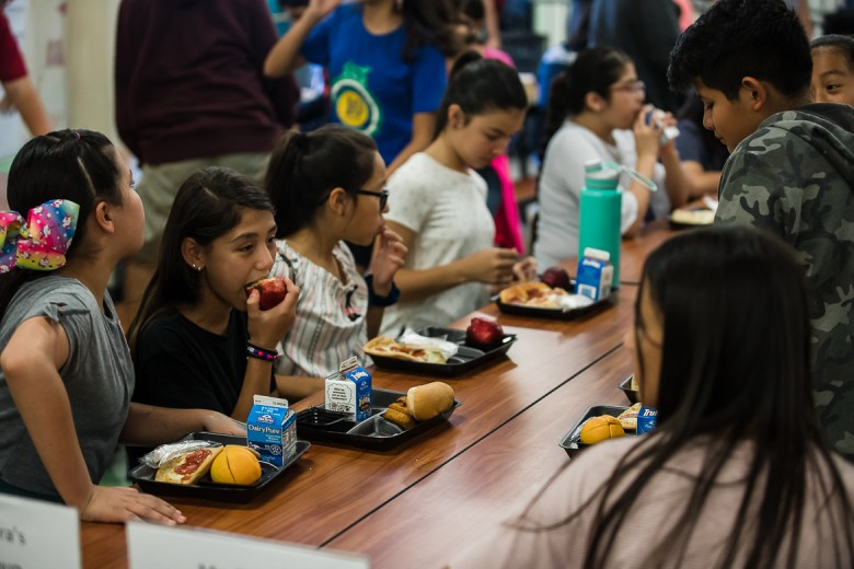 Kids participating at San Antonio ISD's Mexican American Studies camp eating lunch on June 14, 2019.