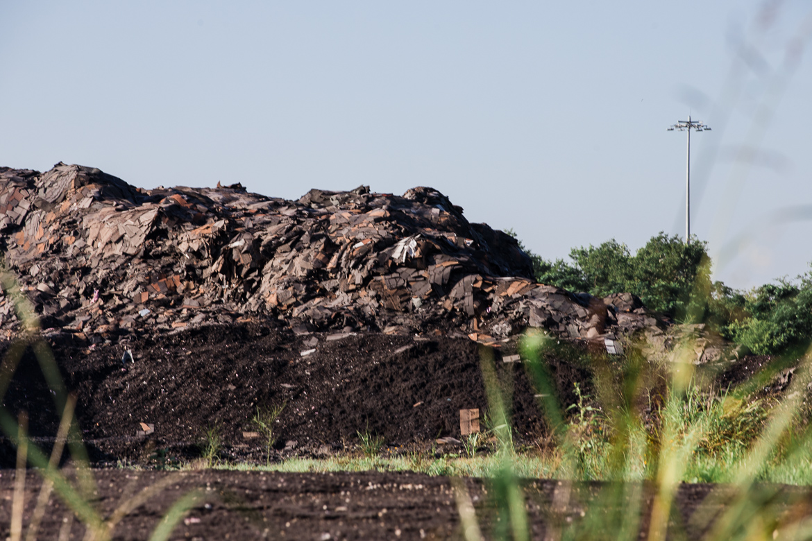 30-foot-high pile of illegally dumped shingles near Leon Creek