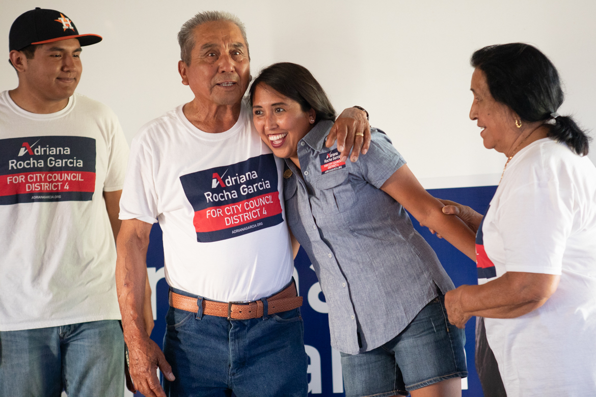 Adriana Rocha Garcia (center right) hugs her father next to her mother and son after early voting results are announced.
