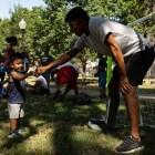 SAFC Defender Moses Hernandez, right, congratulates his son Aaron Hernandez, 1, on scoring a goal.