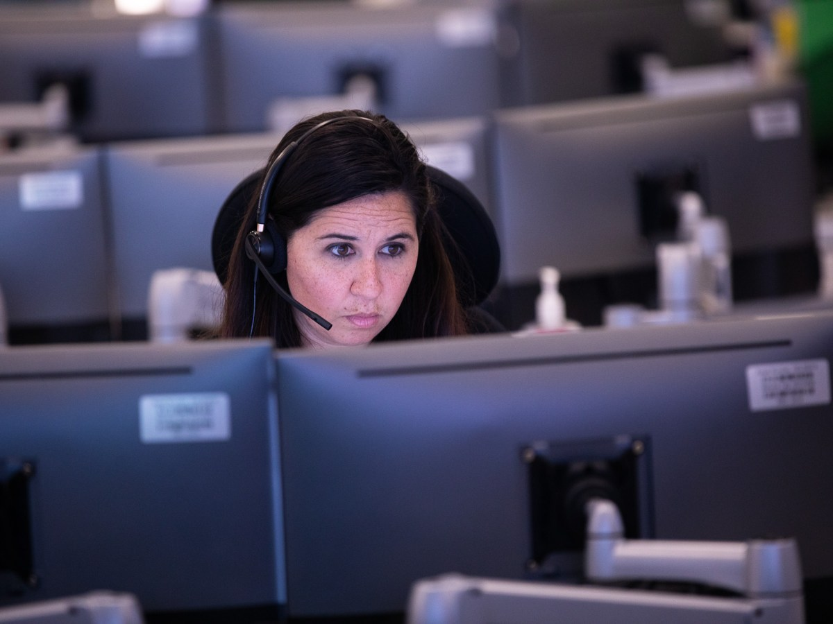 USAA Security Specialist Melissa Bailey takes calls at the unified command center at USAA's San Antonio headquarters.