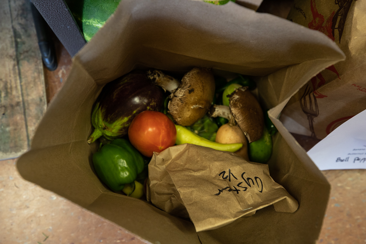 Inside a local produce bag contains seasonal produce items worth $25 for $20 on July 1, 2019.
