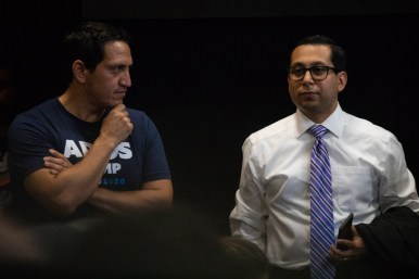 (From left) State Rep. Trey Martinez Fischer (D-San Antonio) and State Rep. Diego Bernal (D-San Antonio) chat before the debate begins.