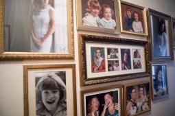 Photos of Deborah Sibley's two daughters line the hallway of her home.