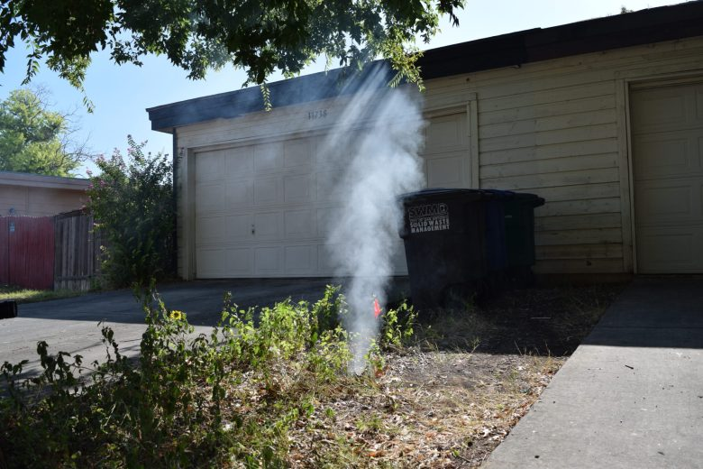 A plume of smoke rises from a broken sewer clean-out cap as the San Antonio Water System conducts smoke testing over the Edwards Aquifer Recharge Zone.