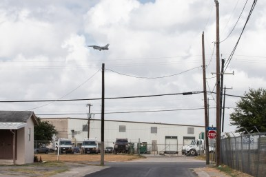 A plane can be seen and heard over the Los Jardines neighborhood.