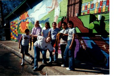 The group that completed the original Peace and Remembrance mural includes Crystal Torres (now Tamez) on the right. Patti Radle is second from left in the top row.