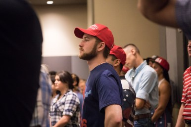 A Donald Trump supporter wears a Make America Great Again hat in the audience.