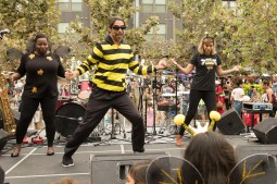 """Participants perform a """"waggle dance"""" to celebrate bees."""